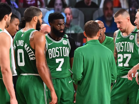 The Celtics stand as a team during a timeout inside the NBA bubble