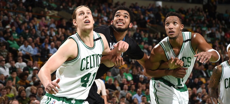 Kelly Olynyk, Karl-Anthony Towns and Evan Turner battle for a rebound