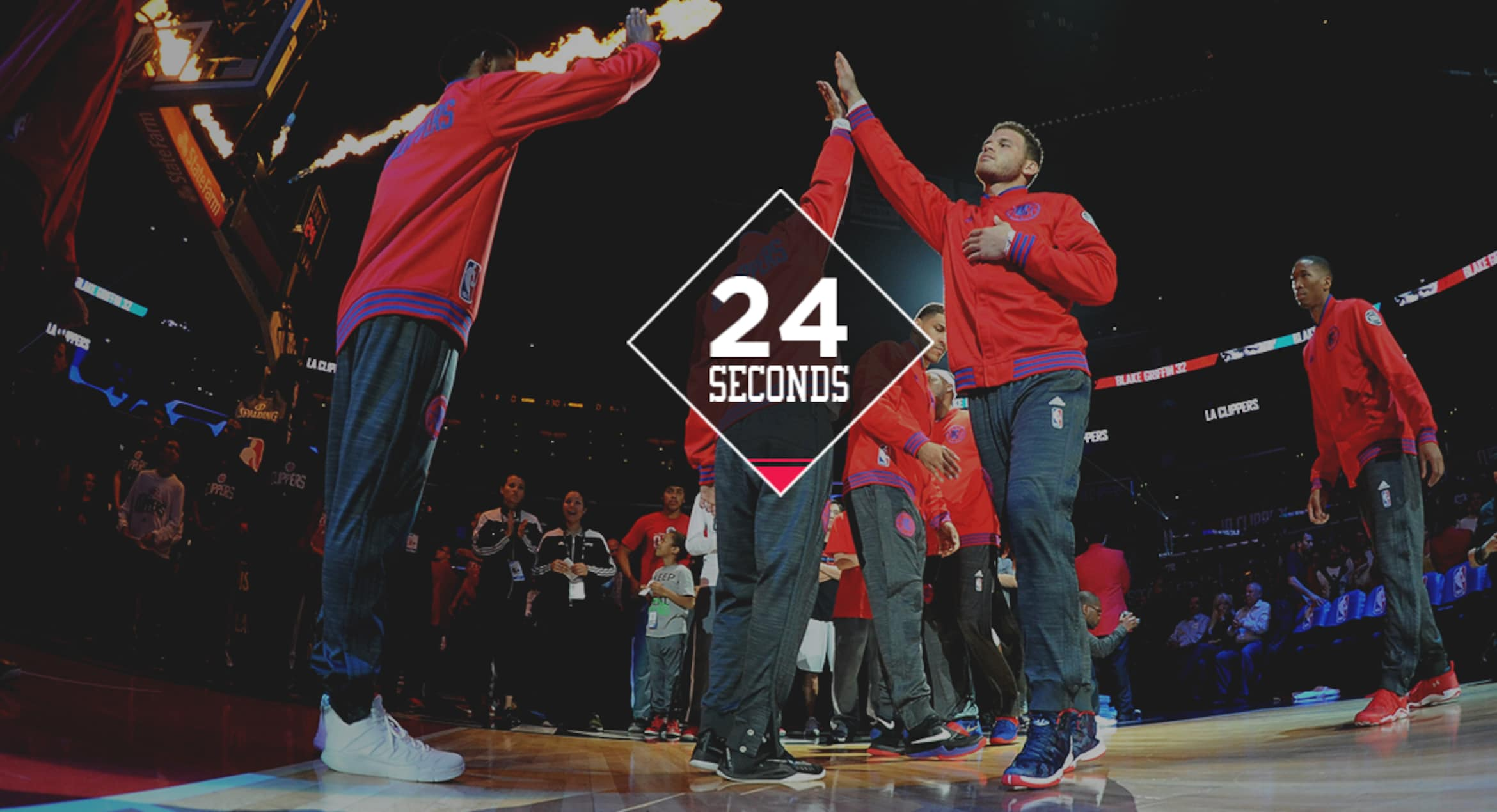 Image of Blake Griffin during pregame player introductions high fiving another player - Article 24 Seconds w/ Blake Griffin