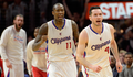 Image of Jamal Crawford and JJ Redick fist pumping on court - Article: Crawford Thriving With Redick, Feels Top SG Tandem