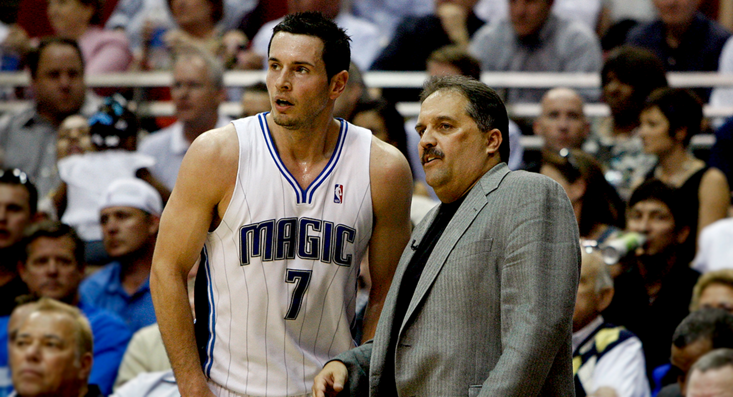 Image of Former Coach Stan Van Gundy of the Orlando Magic speaks to J.J. Redick during their game against the Miami Heat at Amway Arena on October 12, 2007 in Orlando, Florida.