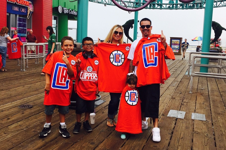 Photos of fans wearing the Clippers new logo shirts