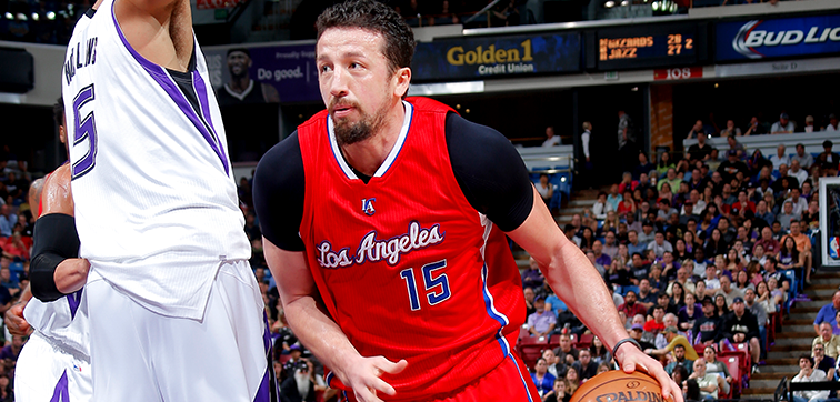 Image of Hedo Turkolgu with game game ball dribbling up court - Article: