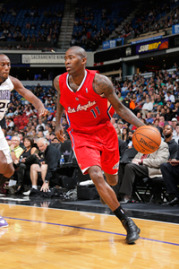Jamal Crawford dribbles the ball in a preseason game vs. the