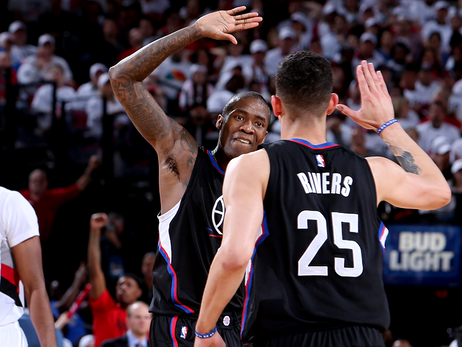 Image of Jamal Crawford high-fiving Austin Rivers in Game 3 or Round one of the Western Quarter Finals against Portland Trail Blazers.