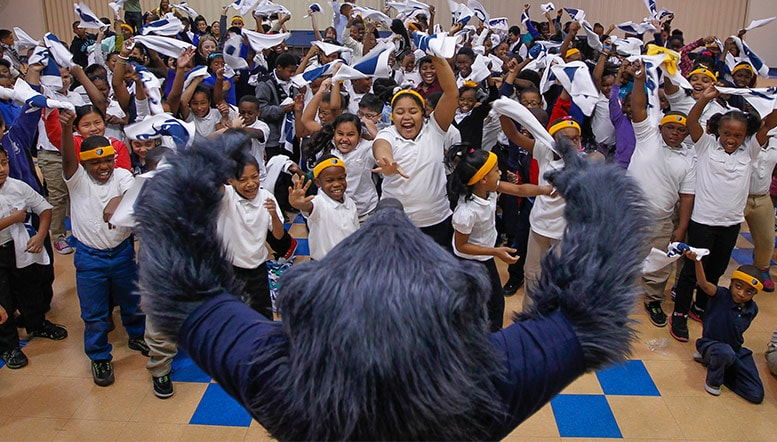 Local elementary School Children cheer for the Grizzlies