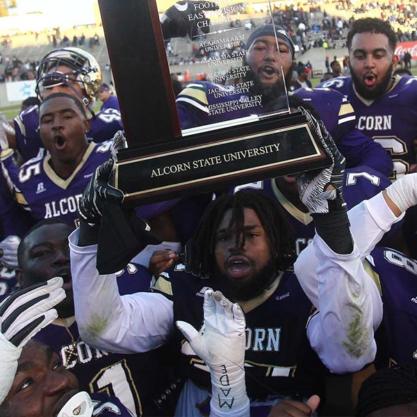 Alcorn State players hoist SWAC East trophy