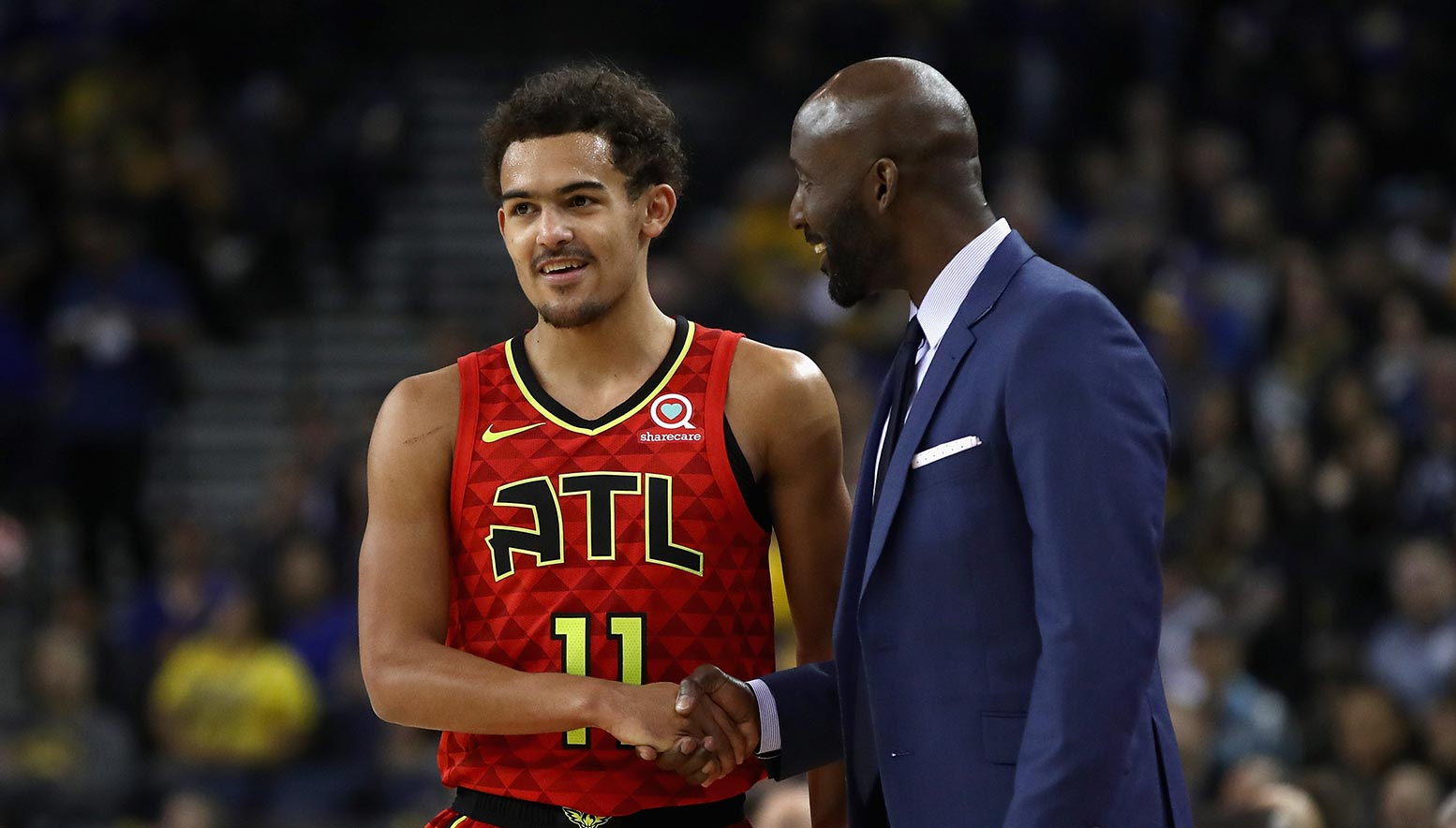 Trae Young shakes hands with Lloyd Pierce