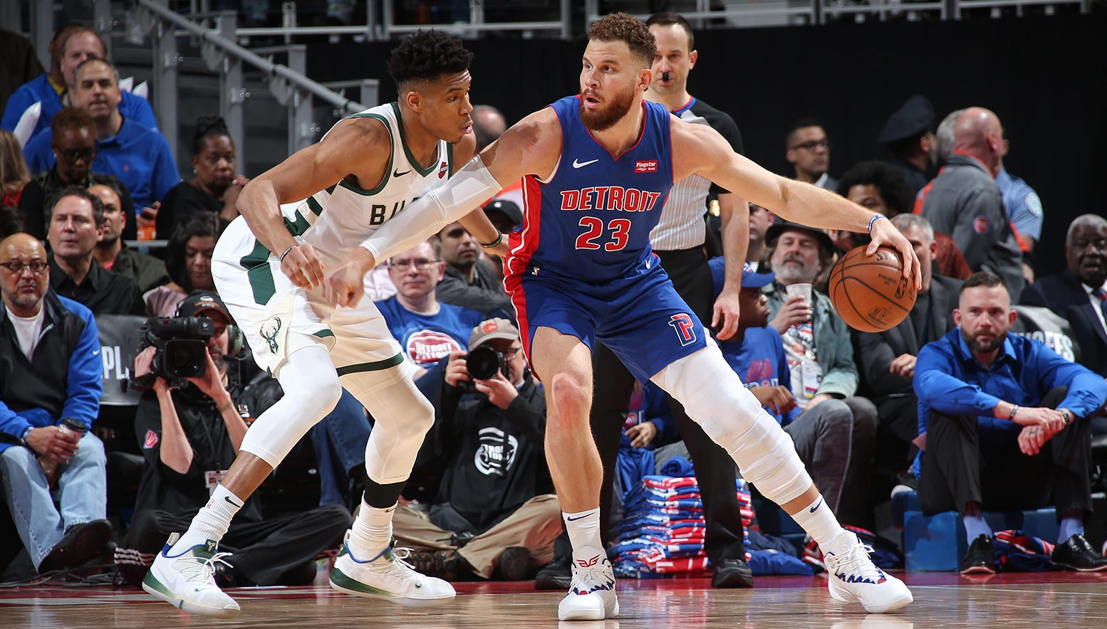 Giannis Antetokounmpo guards Blake Griffin