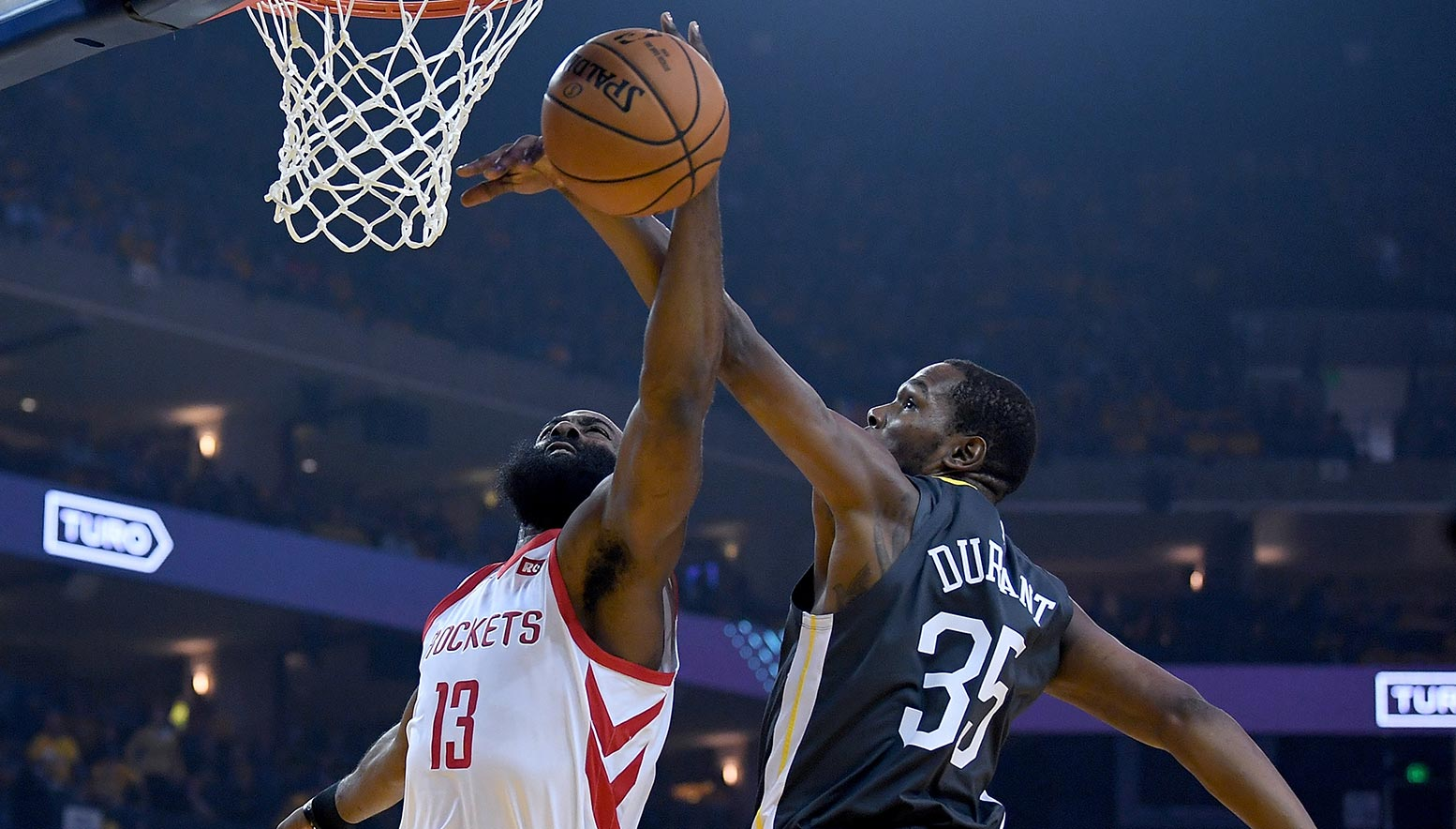 Kevin Durant contests the shot of James Harden