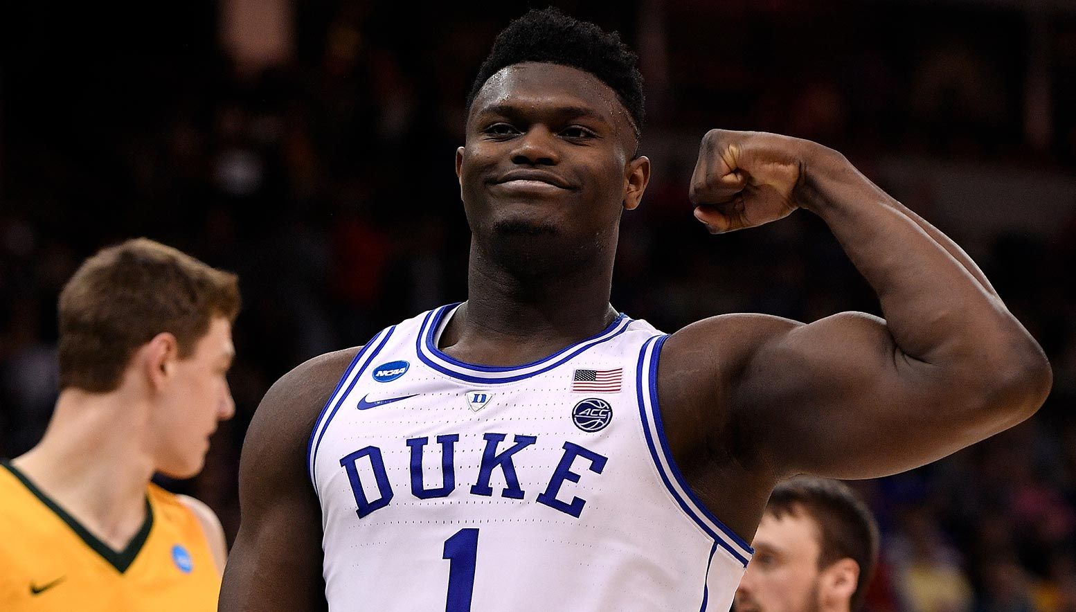 Zion Williamson of Duke flexes