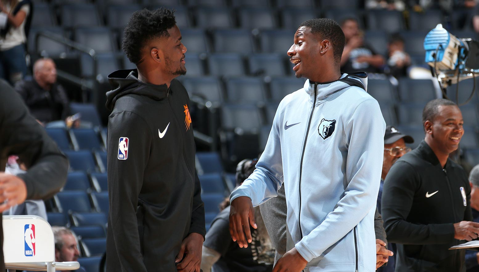 Deandre Ayton #22 of the Phoenix Suns and Jaren Jackson Jr. #13 of the Memphis Grizzlies talk before the game