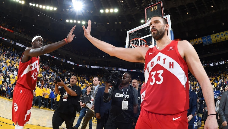 Marc Gasol #33 high fives teammate Paskal Siakam #43 of the Toronto Raptors after the game against the Golden State Warriors during Game Four of the NBA Finals on June 7, 2019 at ORACLE Arena.