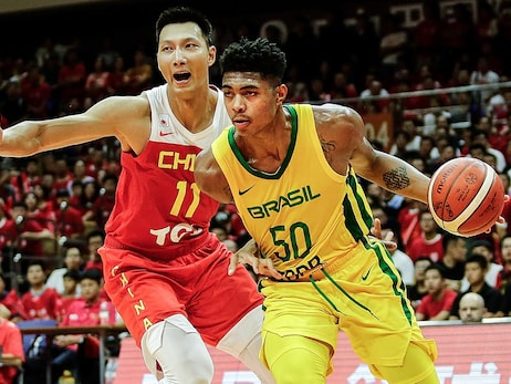 Bruno Correa Fernandes Caboclo #50 of Brazil National Team drives against Yi Jianlian #11 of China National Team during 2019 Sion BRAZIL Men's International Basketball Challenge at Wuhan Sports Center on August 25, 2019 in Wuhan, China.