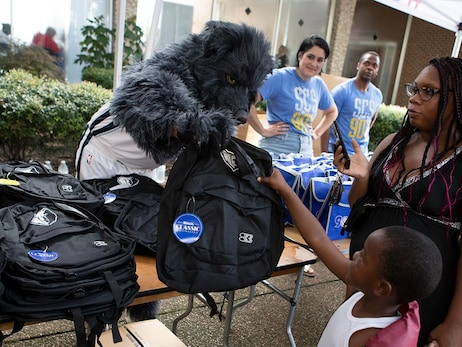 Grizz hands out backpacks at back-to-school block party