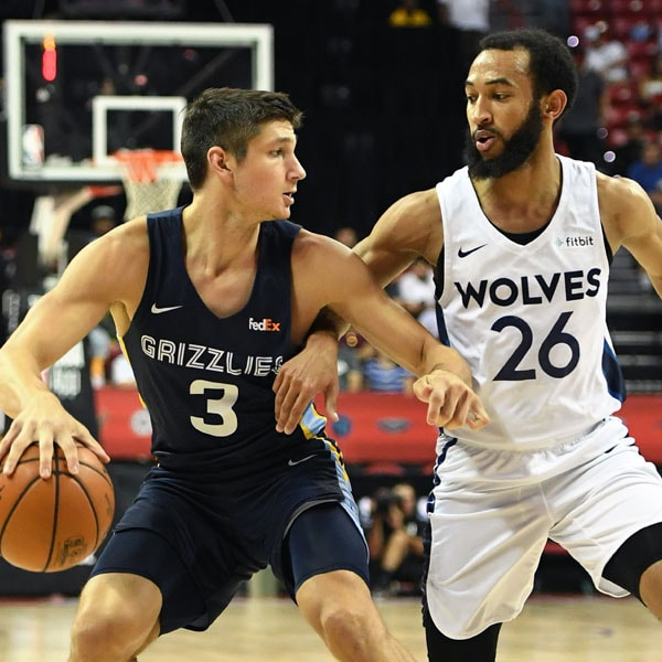 Grayson Allen drives against the Timberwolves