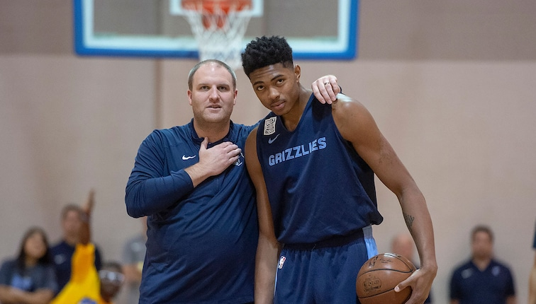 Head Coach Taylor Jenkins, and Bruno Caboclo #5 of the Memphis Grizzlies are seen talking to each other at the Memphis Grizzlies Open Practice on October 5, 2019 at Memphis University School in Memphis, Tennessee.