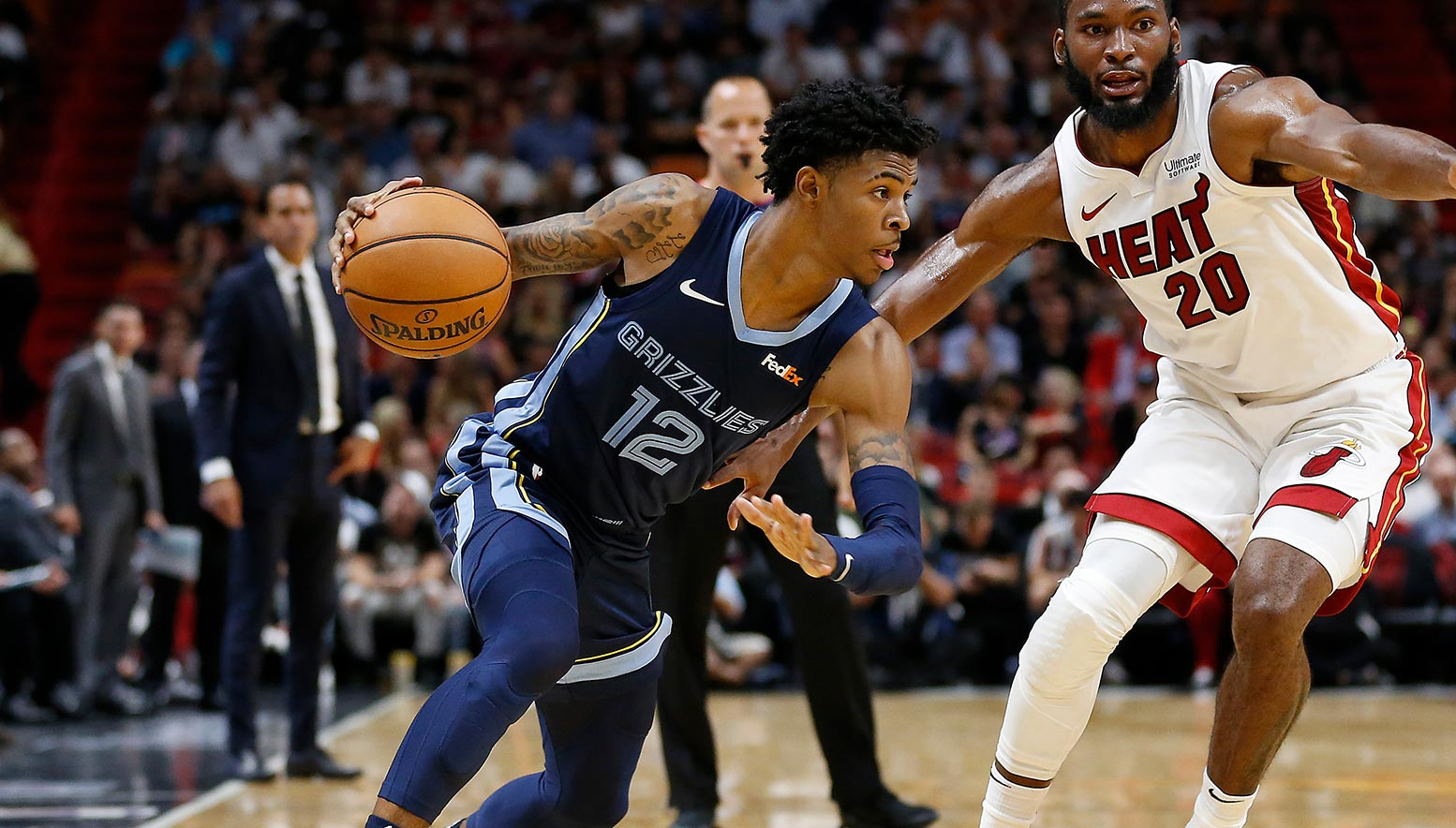 Ja Morant #12 of the Memphis Grizzlies drives to the basket against Justise Winslow #20 of the Miami Heat