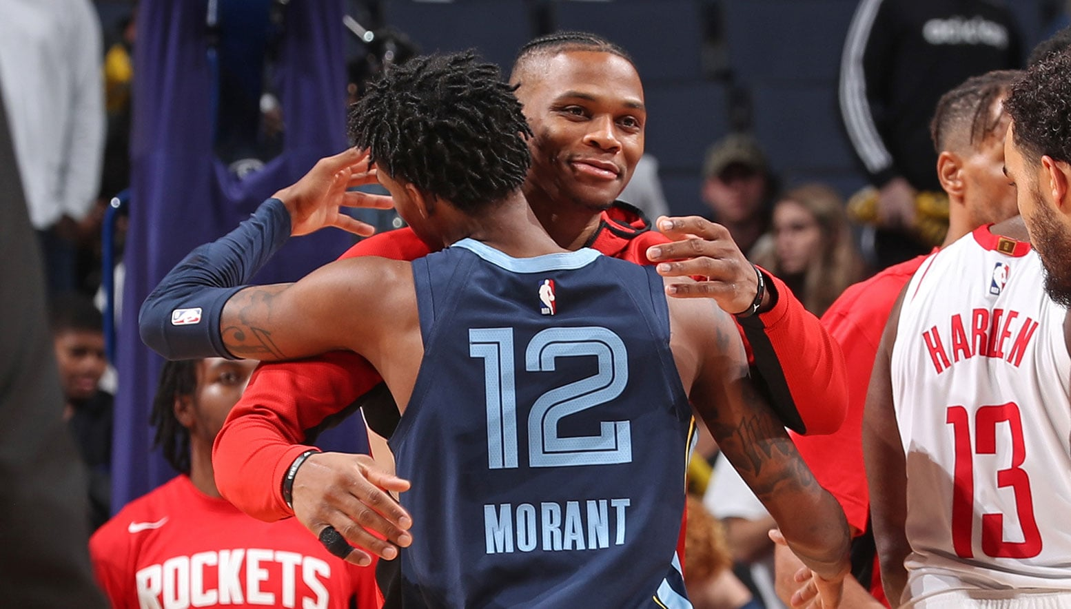 Ja Morant and Russell Westbrook hug