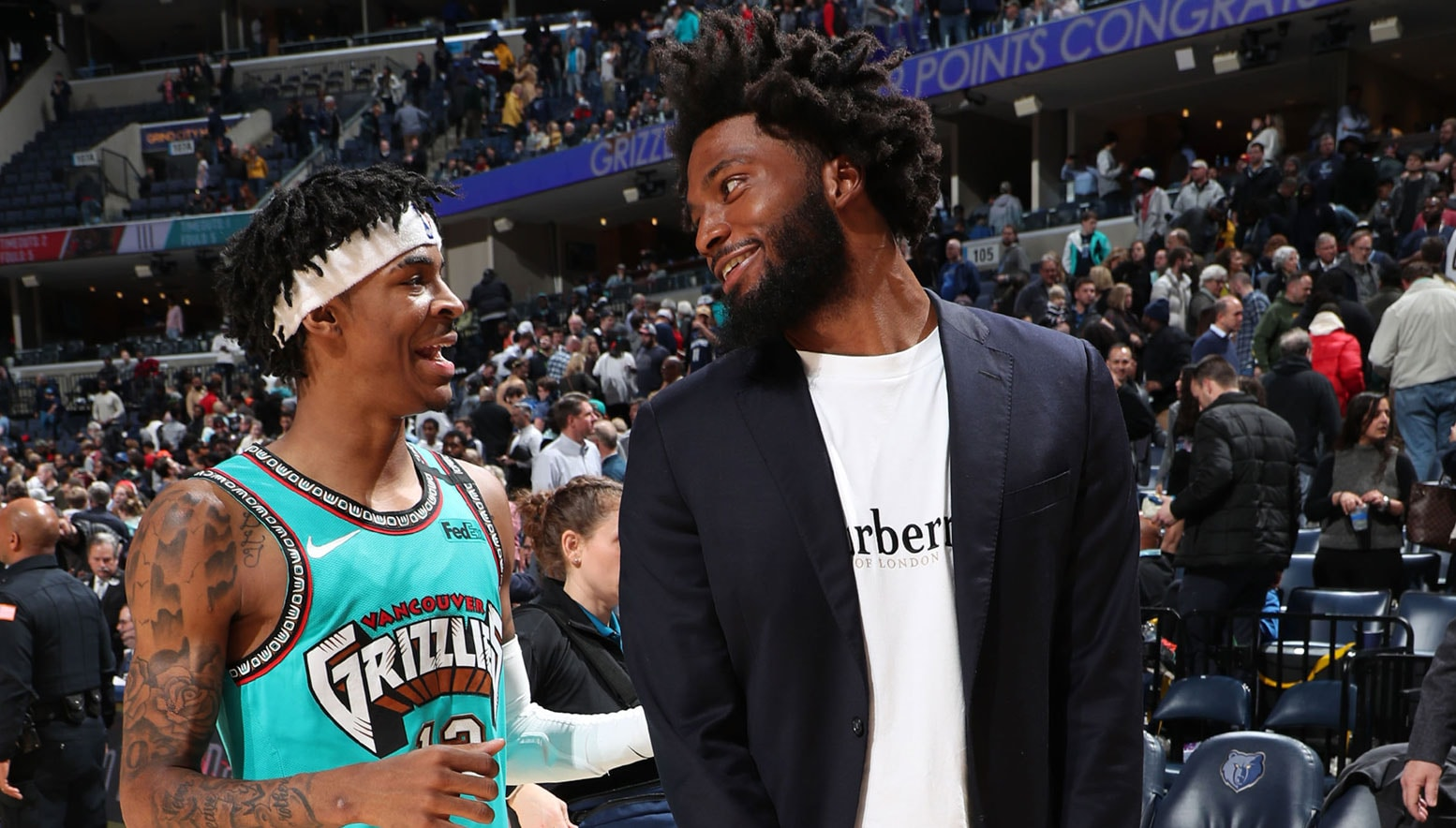 Justise Winslow talking with Ja Morant