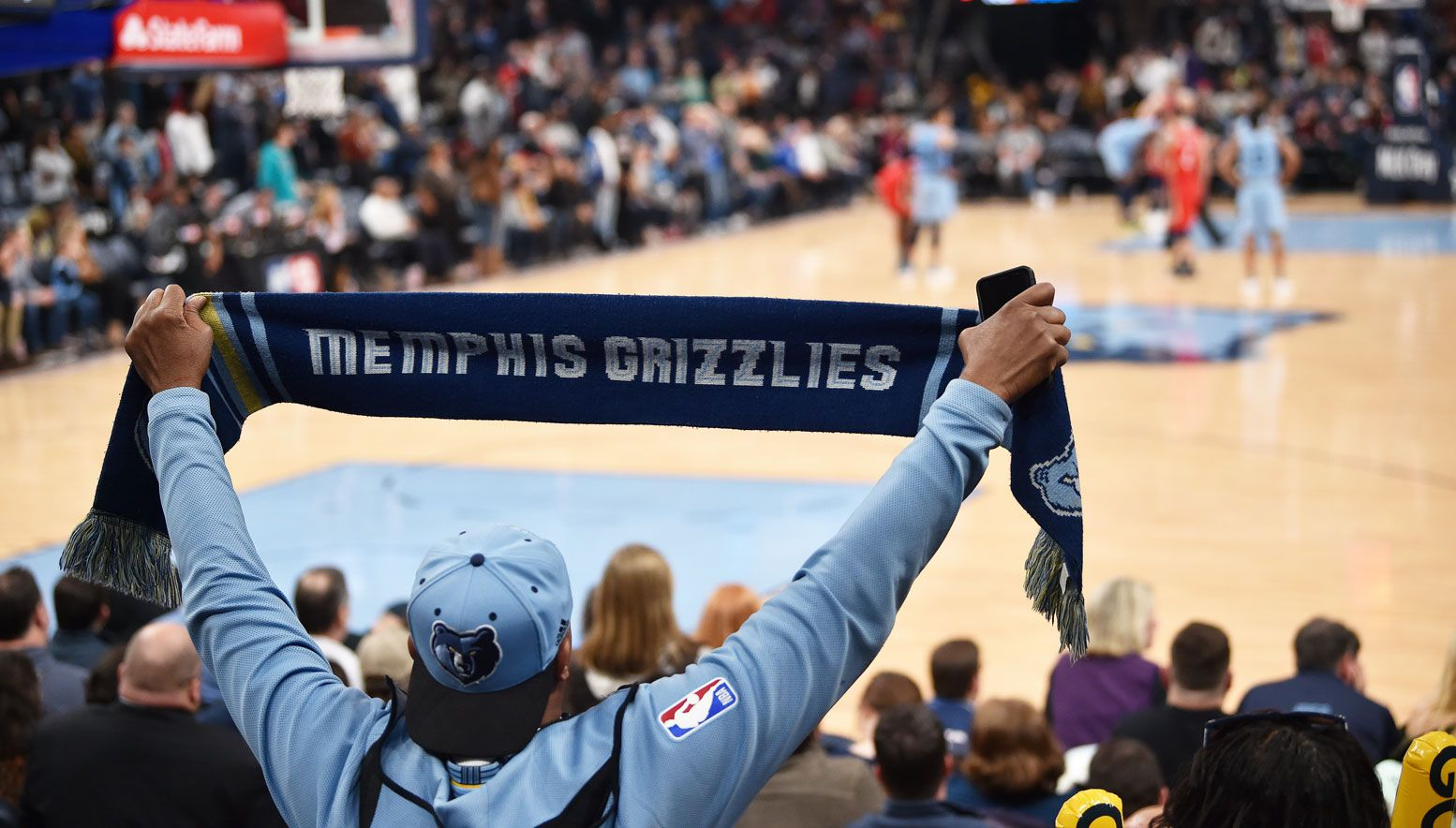 Grizzlies fan holding up a scarf