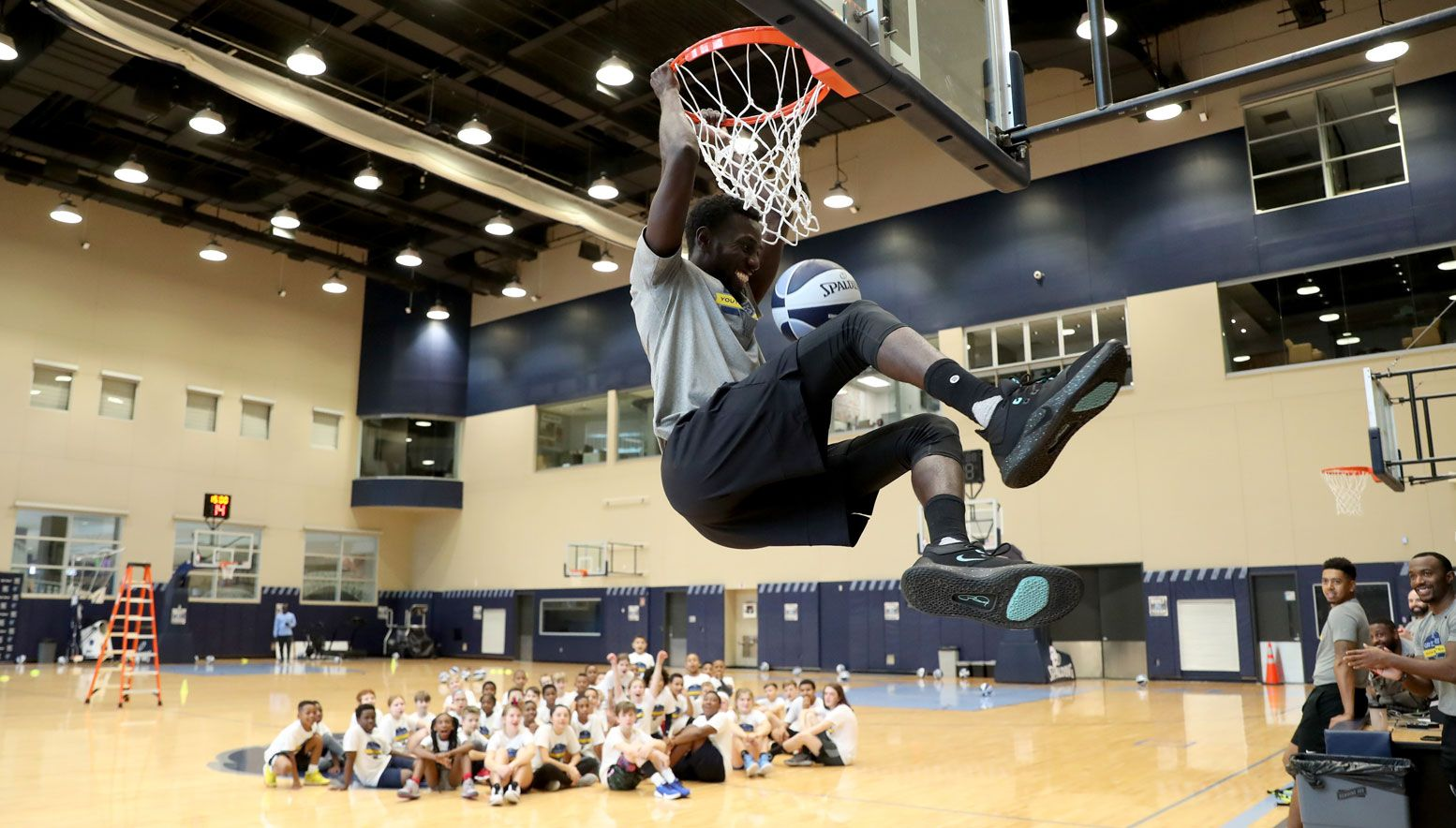 Sidy Sall dunking at a camp