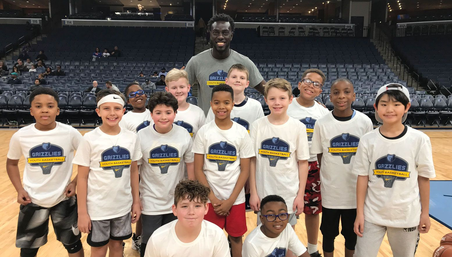 Sidy Sall and kids at a camp