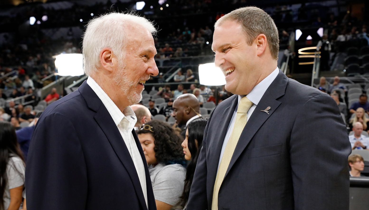 Gregg Popovich and Taylor Jenkins