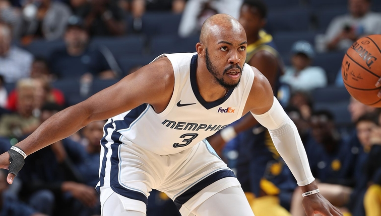 Jevon Carter guards his opponent against the Indiana Pacers