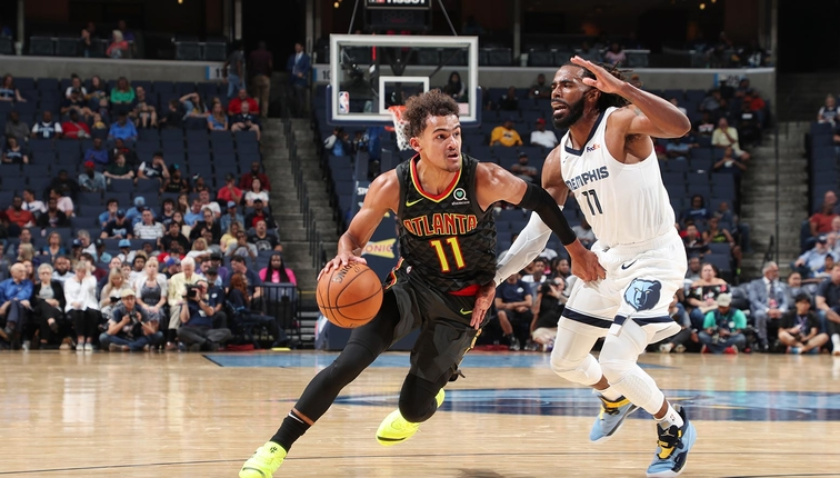 Trae Young #11 of the Atlanta Hawks handles the ball against Mike Conley #11 of the Memphis Grizzlies on October 5, 2018 at FedExForum in Memphis, Tennessee.