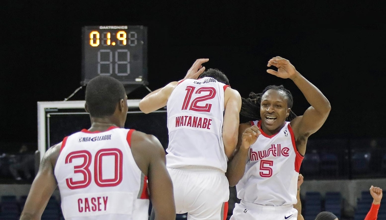 Jay-R Strowbridge #5 of the Memphis Hustle celebrates with teammates against the Stockton Kings during the NBA G League Playoffs on March 27, 2019 at the Stockton Arena in Stockton, California