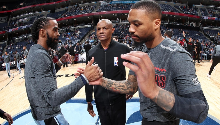 Mike Conley #11 of the Memphis Grizzlies greets Damian Lillard #0 of the Portland Trail Blazers before the game on March 5, 2019 at FedExForum in Memphis, Tennessee