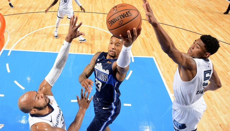 Trey Burke #23 of the Dallas Mavericks shoots the ball during the game against the Memphis Grizzlies on March 2, 2019 at the American Airlines Center in Dallas, Texas.