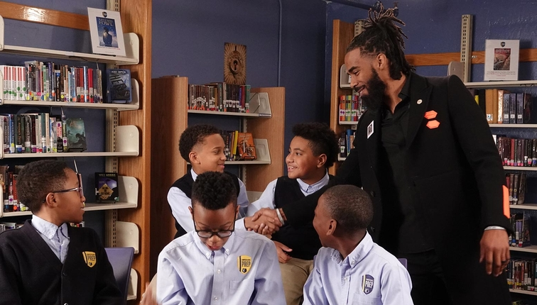 Mike Conley #11 of the Memphis Grizzlies meets school children for Martin Luther King Jr. Day on January 10, 2019 at the Memphis Grizzlies Preparatory Charter School in Memphis, Tennessee