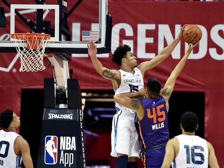 Brandon Clarke #15 of the Memphis Grizzlies blocks the shot of Derek Willis #45 of the Phoenix Suns during Day 5 of the 2019 Las Vegas Summer League on July 9, 2019 at the Thomas & Mack Center in Las Vegas, Nevada.
