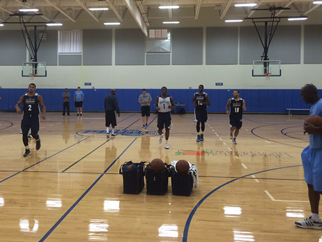 The Grizzlies tip off practice with a good stretch.