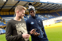 Chelsea star and fellow German Andre Schurrle chats with Dennis Schröder.