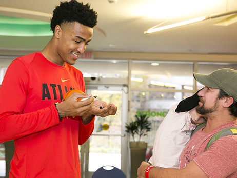 John Collins Spreads Holiday Cheer at Children's Hospital