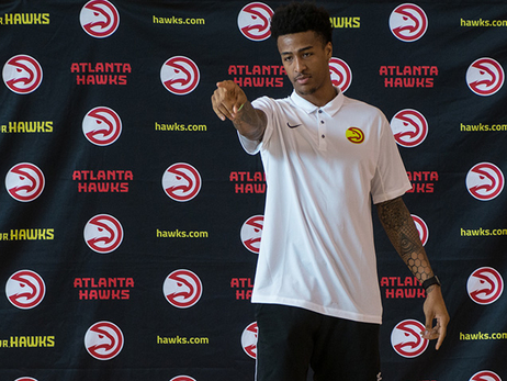 John Collins Shop Talks With Jr. Hawks