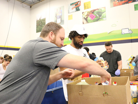 Hawks Players, Coaches and Staff Volunteer at Atlanta Community Food Bank