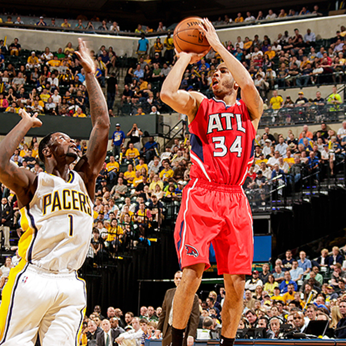 Devin Harris shoots for three over Lance Stephenson.
