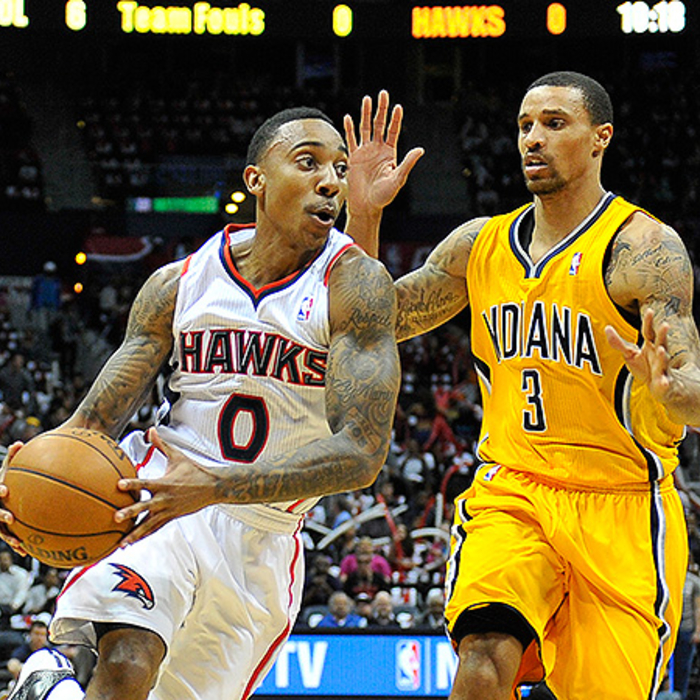 Jeff Teague moves around George Hill.