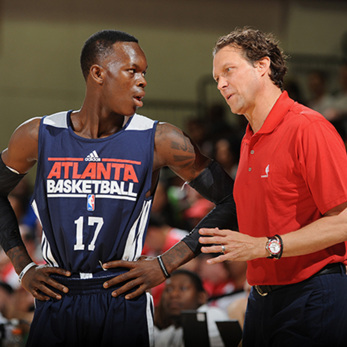Assistant Coach Quin Snyder talks to Dennis Schröder during a timeout.