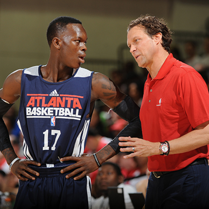 Assistant Coach Quin Snyder talks to Dennis Schroder on the sidelines.