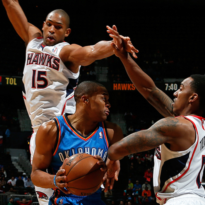 Al Horford and Jeff Teague go up to block Russell Westbrook.