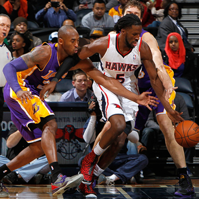 DeMarre Carroll beats Kobe Bryant to the ball.