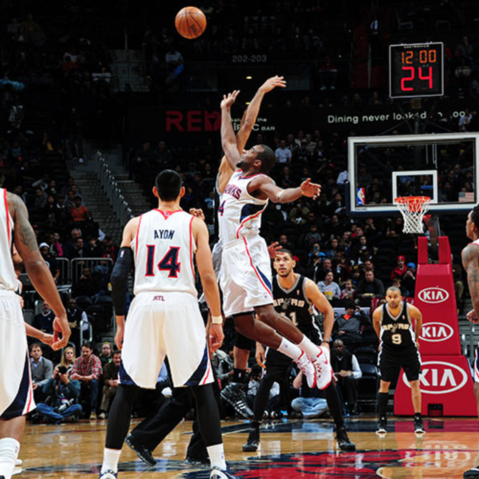 Paul Millsap going up for the tip.