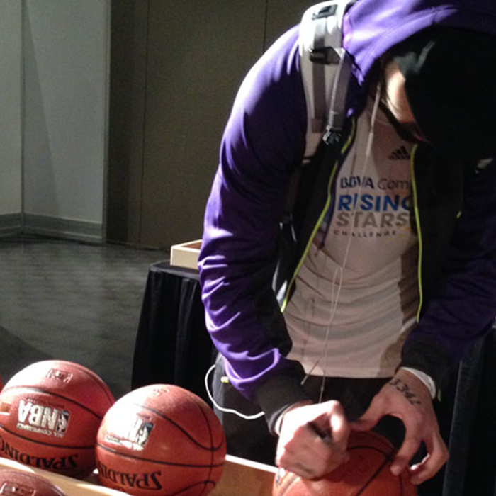 The Hawks Pero Antic autographing basketballs before the Rising Stars Practice.