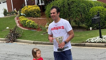 Hawks Travel & Equipment Manager Completes Marathon with Support from Hawks Players, Coaches