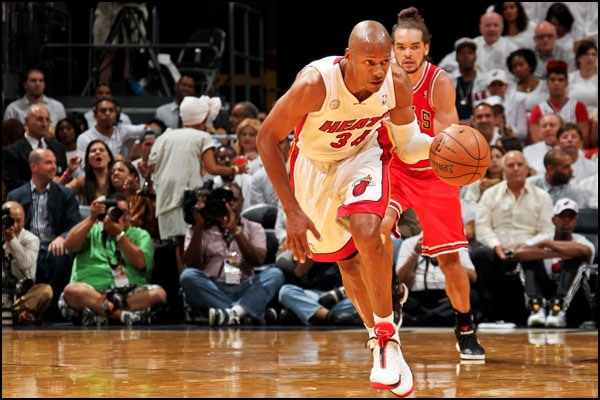 Ray Allen dribbles the ball up the court